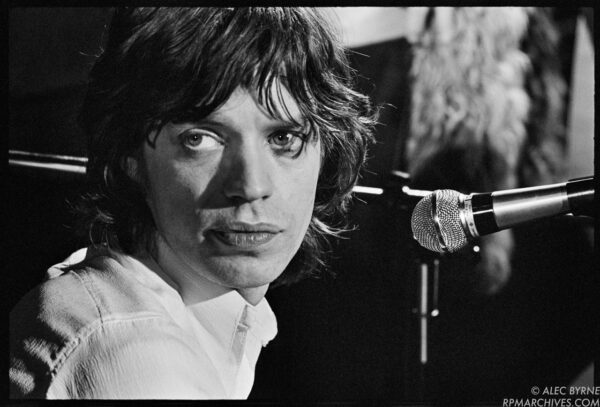 March 26,1971, London - Mick Jagger takes a moment during soundcheck with the Rolling Stones prior to filming a TV special at the Marquee club. © Alec Byrne