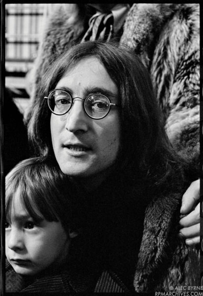 """Dec 11, 1968, London - John Lennon of the Beatles waits with his son Julian prior to filming the """"Rock and Roll Circus"""" TV special. © Alec Byrne"""
