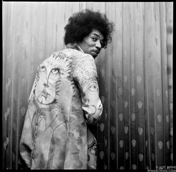 May 7, 1967, London - Jimi Hendrix poses backstage at the Saville Theatre, sporting a new psychedelic jacket given to him as a gift by Chris Jagger, brother of Rolling Stones vocalist Mick Jagger. © Alec Byrne